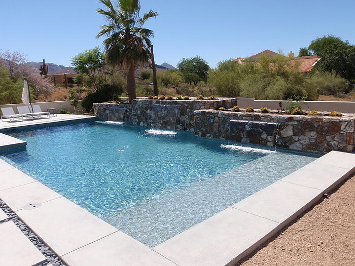 This is a geometric pool design with a waterfall feature.