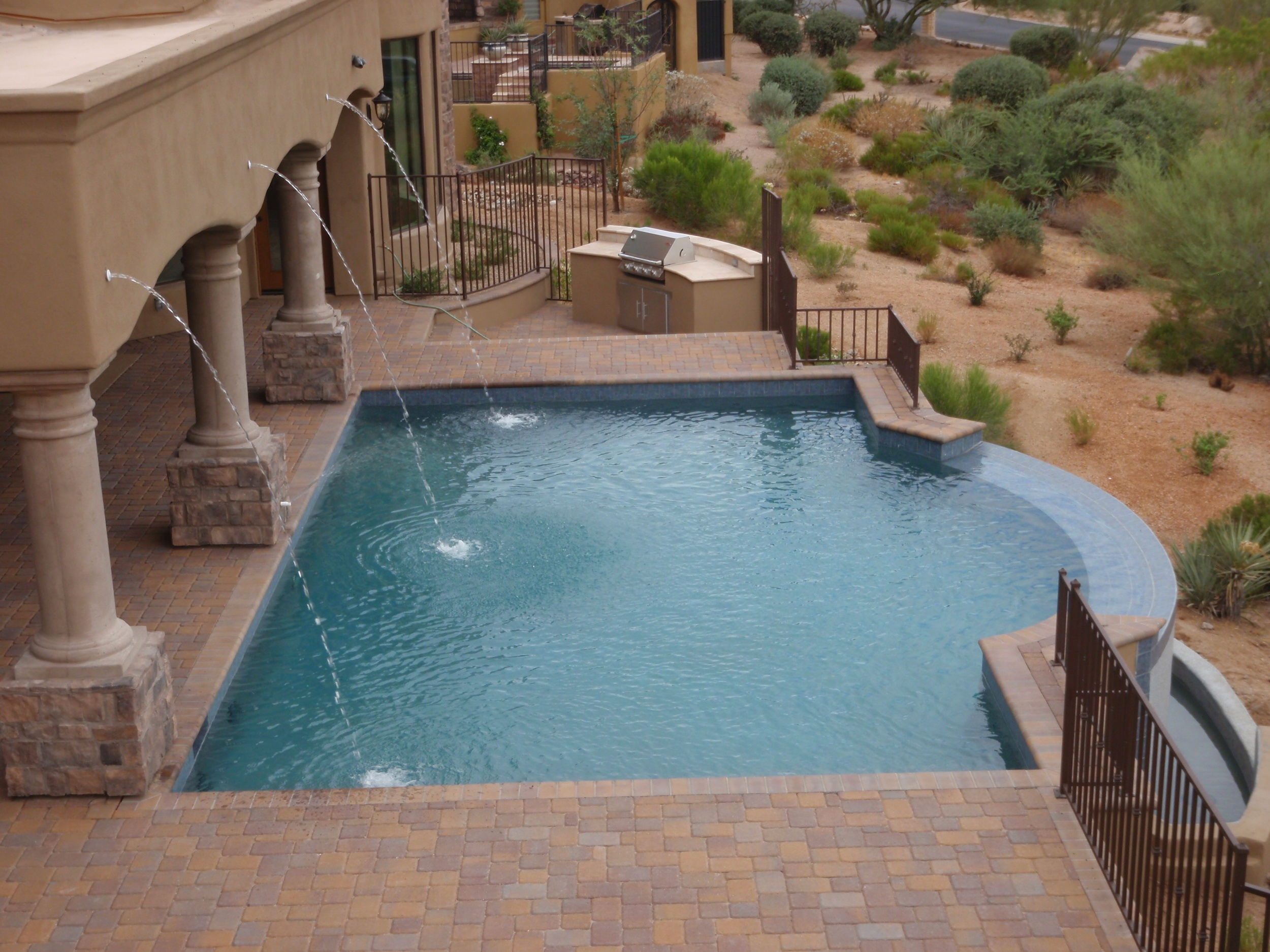 do you love tall plants columns and want an elegant look all while keeping the sleek sides of a rectangle pool the roman style pool is perfect for you - Roman Swimming Pool Designs